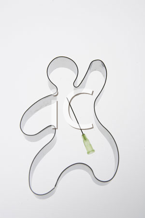 Gingerbread cookie cutter with a needle tip in the middle.