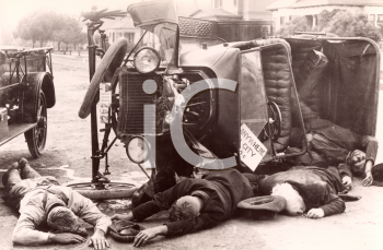 Royalty Free Photo of an Accident Involving a Classic Car with Injured People