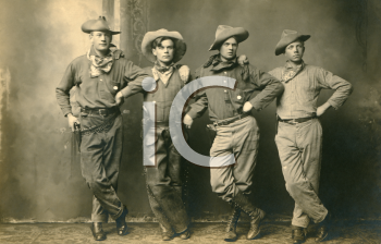 Royalty Free Photo of Four Cowboys
