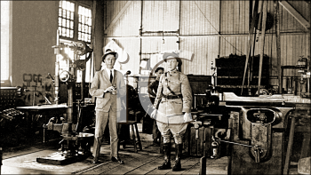Royalty Free Photo of Two Men in a Factory