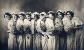 Royalty Free Photo of Ladies Holding Floral Bouquets