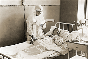 Royalty Free Photo of a Nurse and Patient in a Hospital