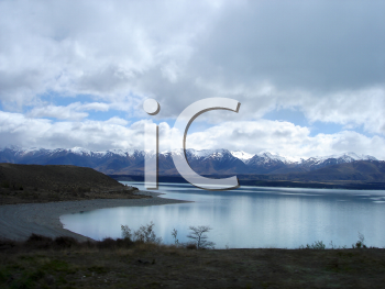 Royalty Free Photo of Mountains, Clouds and a Shoreline