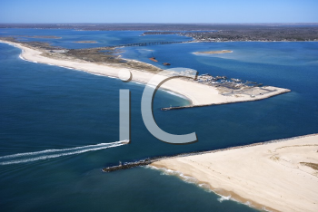 Royalty Free Photo of an Aerial View of a Boat Entering Shinnecock Bay in New York