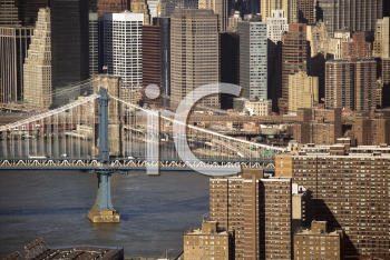 Royalty Free Photo of an Aerial View of Brooklyn Bridge and Manhattan Bride and New York City Buildings