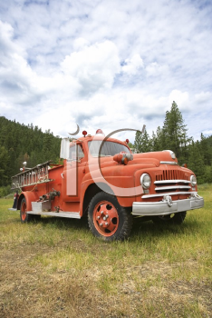 Royalty Free Photo of an Old Fire Truck in a Field