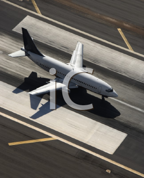 Royalty Free Photo of an Aerial View of a Passenger Airplane on an Airport Runway