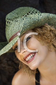 Royalty Free Photo of a Woman Wearing a Hat Smiling