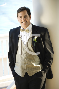 Royalty Free Photo of a Groom in a Tuxedo Smiling