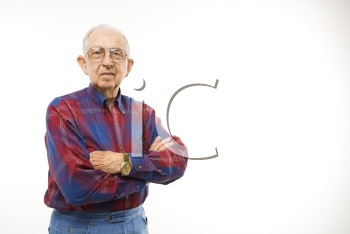 Royalty Free Photo of an Elderly Man Wearing a Plaid Shirt With Arms Crossed