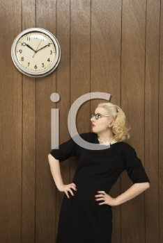 Royalty Free Photo of a Woman Watching a Clock