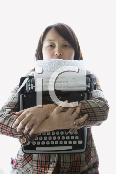 Royalty Free Photo of a Woman Holding a Typewriter