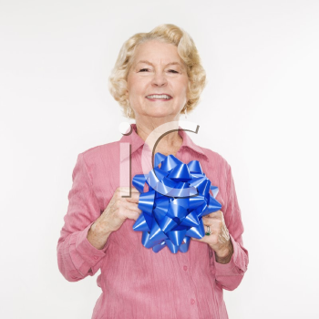 Royalty Free Photo of an Older Woman Holding a Blue Bow