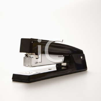 Black stapler on white background.