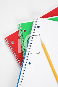 Royalty Free Photo of a Pencil on Top of Three Spiral Bound Notebooks