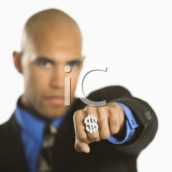 Royalty Free Photo of a Man Wearing a Dollar Sign Ring