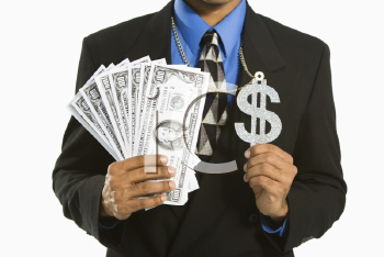 Royalty Free Photo of an African American Man in a Suit Wearing a Necklace With a Money Sign and Holding Cash