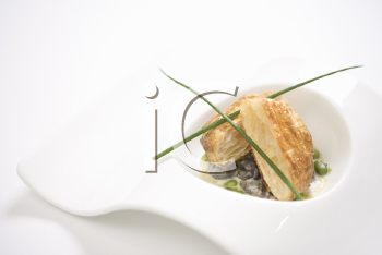 Royalty Free Photo of Escargot en Croute With Butter and Fava Beans