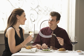 Royalty Free Photo of a Couple Dining in a Restaurant and Smiling