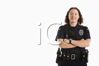 Royalty Free Photo of a Policewoman Standing With Her Arms Crossed