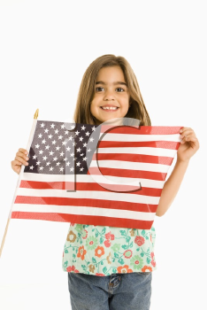 Royalty Free Photo of a Girl Holding an American Flag and Smiling