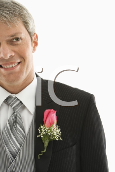 Royalty Free Photo of a Man in a Tuxedo with a Boutonniere