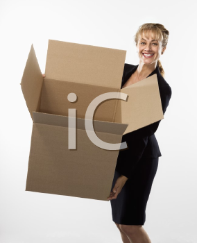 Royalty Free Photo of a Businesswoman Standing Holding an Empty Cardboard Box