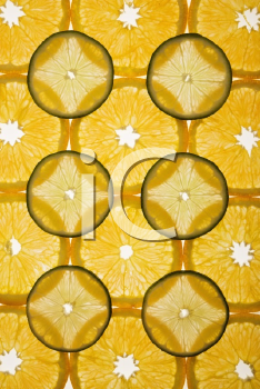 Royalty Free Photo of Orange and Lime Slices Arranged in a Design on a White Background