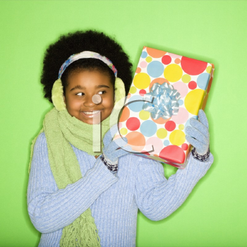 Royalty Free Photo of a Smiling Girl Holding a Present