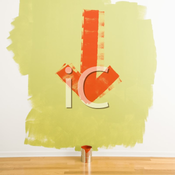 Royalty Free Photo of a Red Arrow Painted on a Wall Pointing to a Can of Paint on the Floor