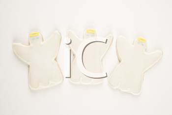 Three angel sugar cookies with decorative icing.