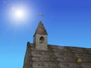 Royalty Free Video of a Church Steeple and a Flock of Birds on a Sunny Day