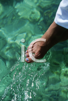 Royalty Free Photo of a Woman's Foot in the Water