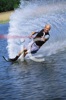 Royalty Free Photo of a Man Water Skiing