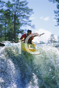 Royalty Free Photo of a Kayaker Coming Over the Falls