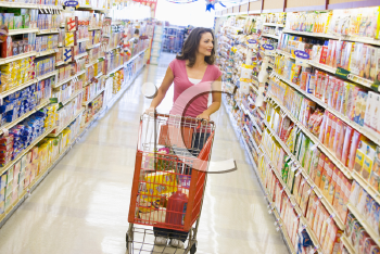 Royalty Free Photo of a Woman Shopping for Groceries