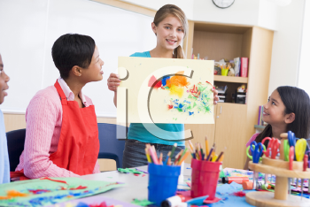 Royalty Free Photo of a Student Showing Artwork