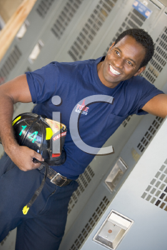 Royalty Free Photo of a Firefighter Holding a Helmet