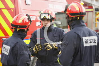 Royalty Free Photo of Three Rescue Workers