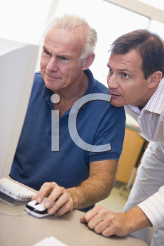 Royalty Free Photo of Two Men Looking at a Computer