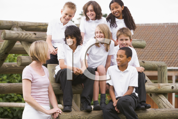 Royalty Free Photo of Students and a Teacher Outside