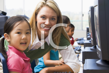 Royalty Free Photo of a Teacher Helping a Student