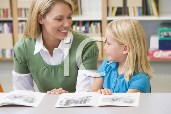 Royalty Free Photo of a Girl With a Teacher