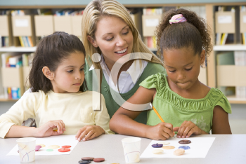 Royalty Free Photo of Two Girls With a Teacher in Art Class