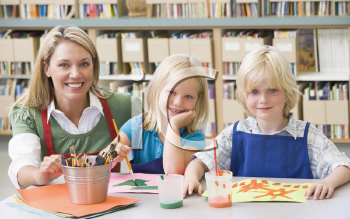 Royalty Free Photo of Students in Art Class With a Teacher