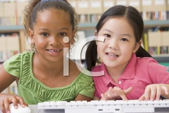 Royalty Free Photo of Two Girls With a Computer
