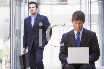 Royalty Free Photo of a Two Men in an Office Lobby