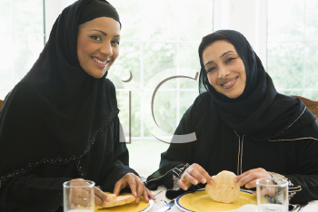 Royalty Free Photo of Two Women Eating