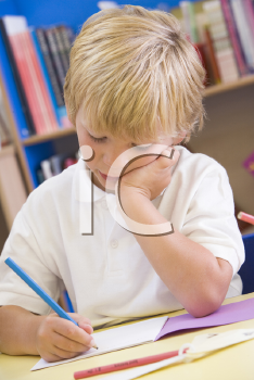 Royalty Free Photo of a Boy Working in School