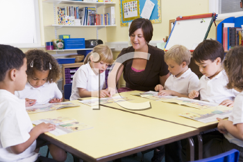 Royalty Free Photo of a Teacher and Students
